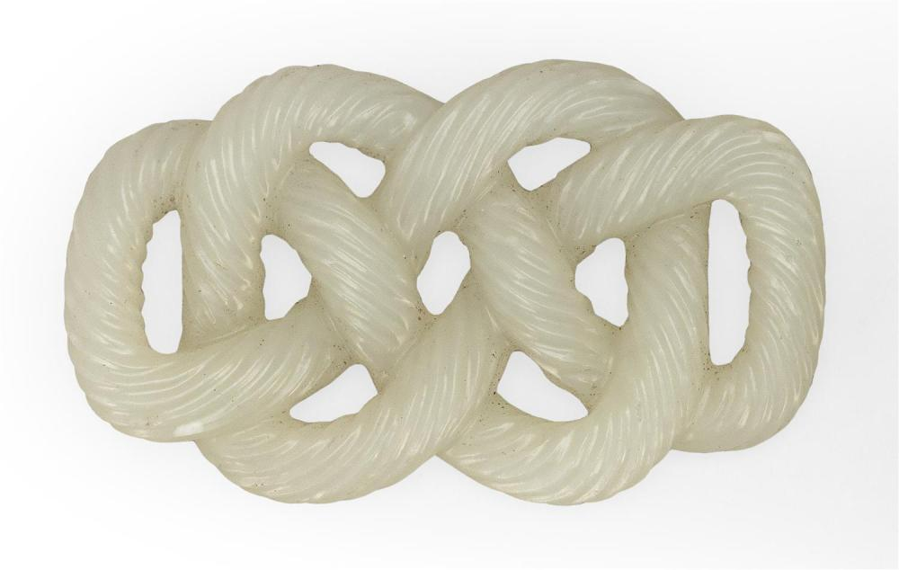 WHITE JADE CARVING In the form of tightly spun rope formed as an endless knot, one of the eight sacred elements. Rope with broad rid...