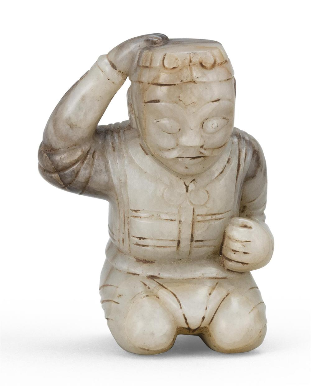 WHITE AND BLACK JADE CARVING OF A MONGOLIAN WARRIOR Mustachioed warrior wearing lamelar armor, holding a war hat in his right hand,...