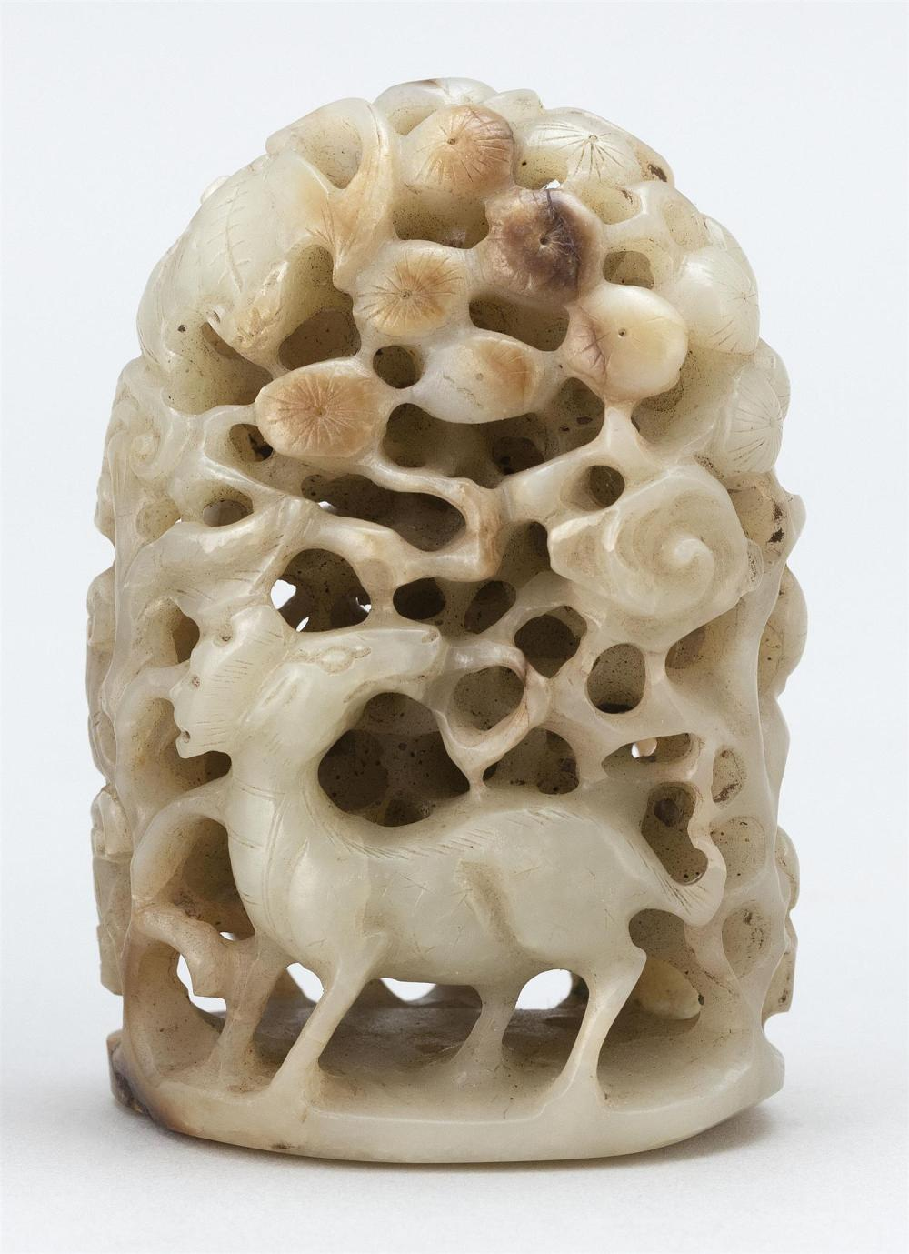 GRAY AND RUSSET JADE FINIAL In mountain form with dramatic openwork carving of heron, millet stems, pine trees, mushrooms, deer and...