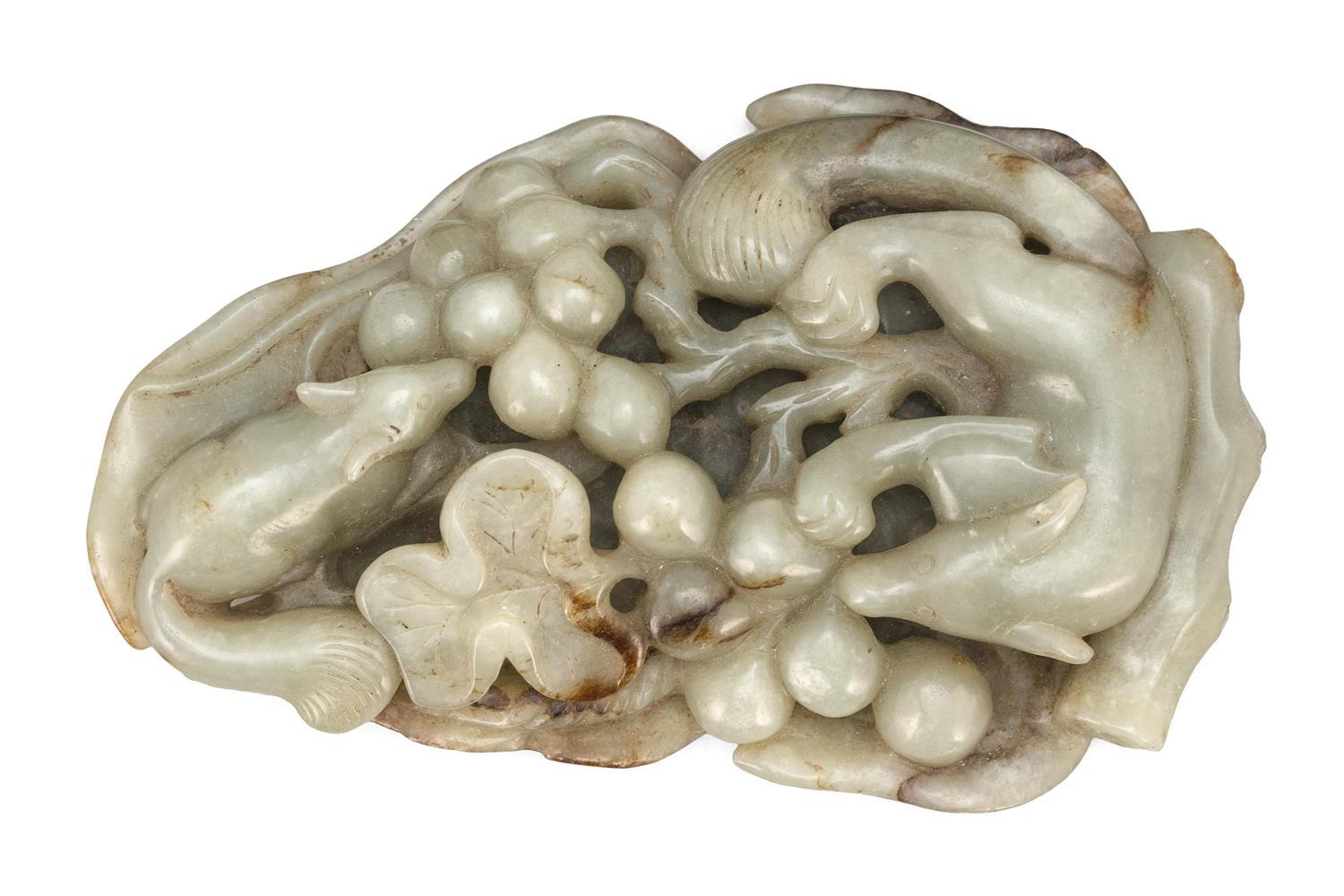 GRAY AND RUSSET JADE SCROLL WEIGHT In the form of two squirrels and clusters of grapes within an openwork leaf, embodying the theme...