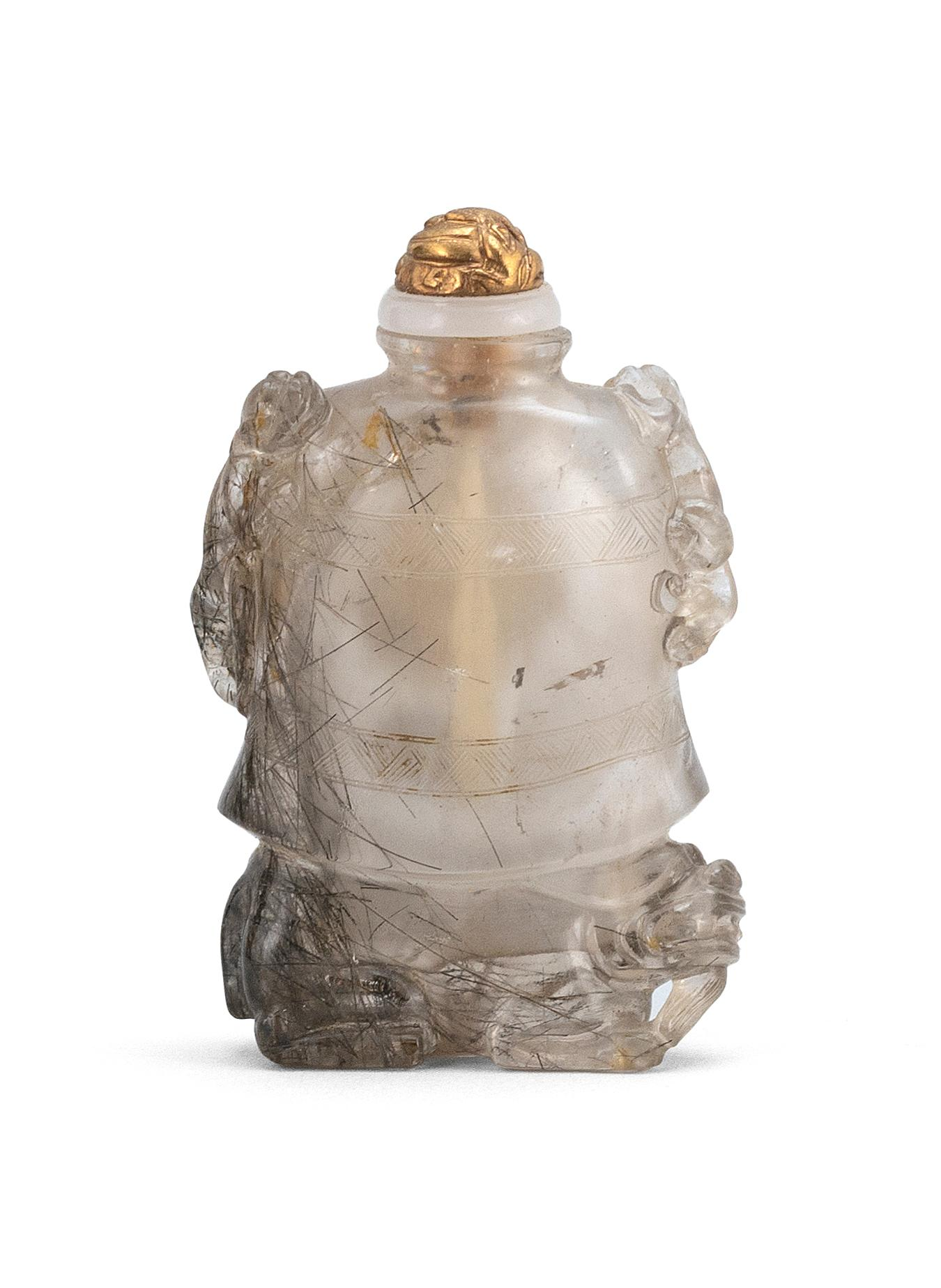 CHINESE HAIR CRYSTAL SNUFF BOTTLE In the form of a giant temple bell on the back of a crouching qilin. Bell with dragon handles and...