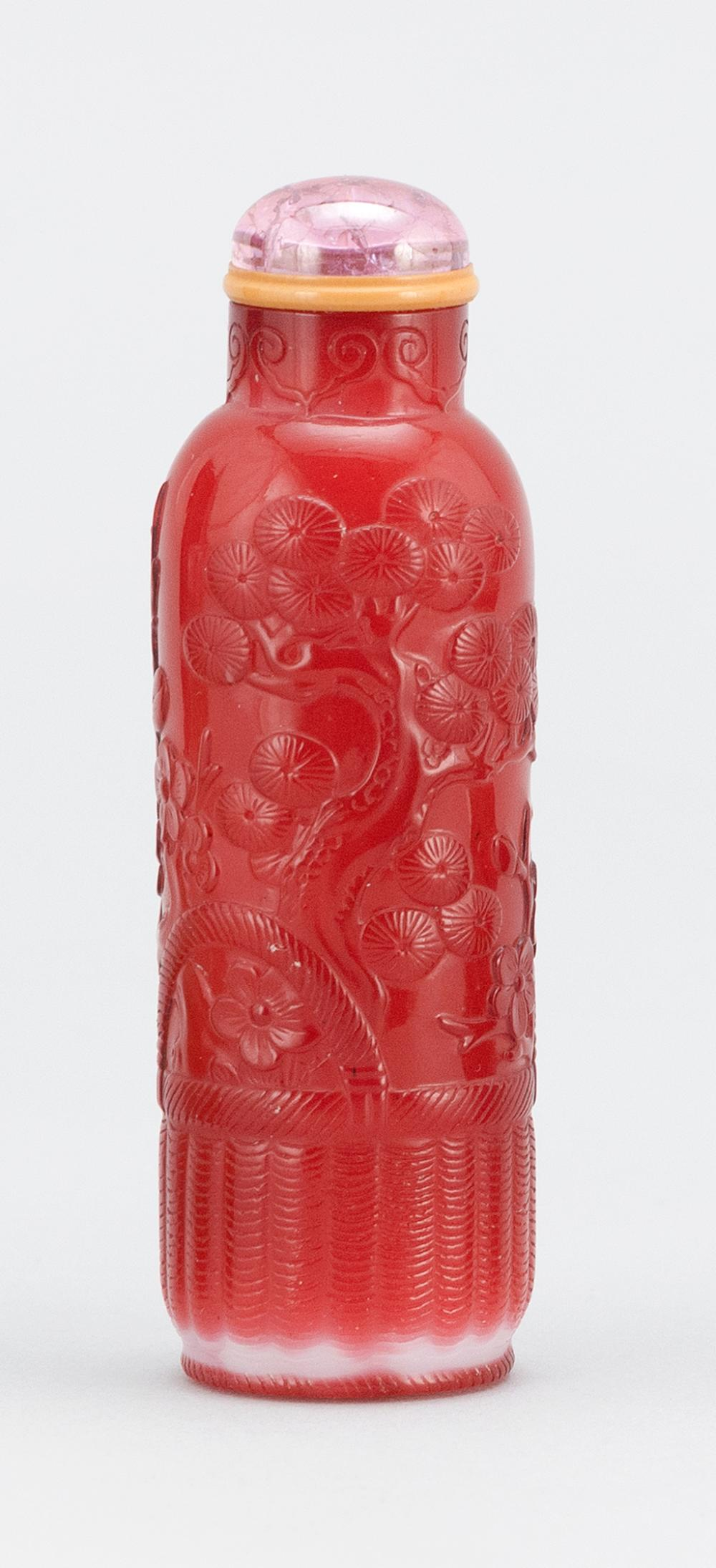 SUPERB CHINESE RED OVERLAY ON MILK WHITE GLASS SNUFF BOTTLE Cylindrical, with delicate carving of the Three Friends (pine, prunus an...