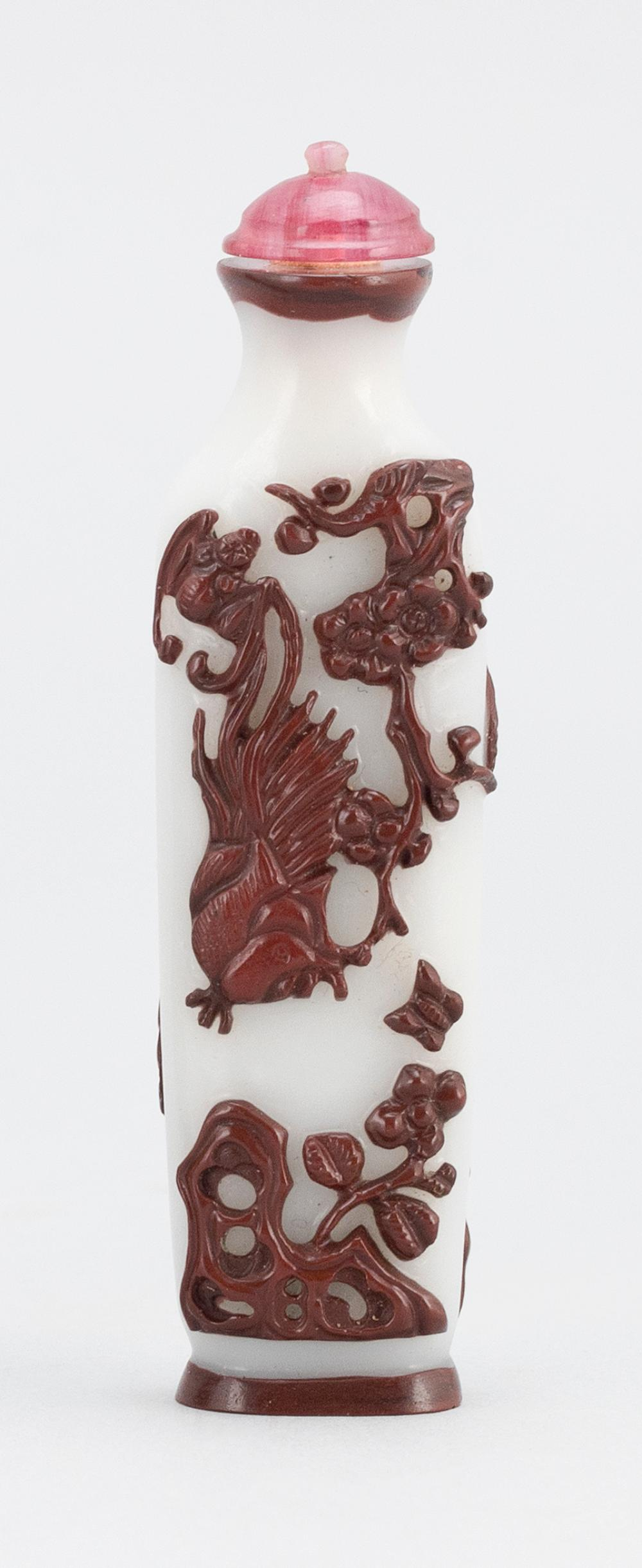 CHINESE BRICK RED ON WHITE OVERLAY GLASS SNUFF BOTTLE In amphora form, with a bird, bat and prunus design. Height 3.2