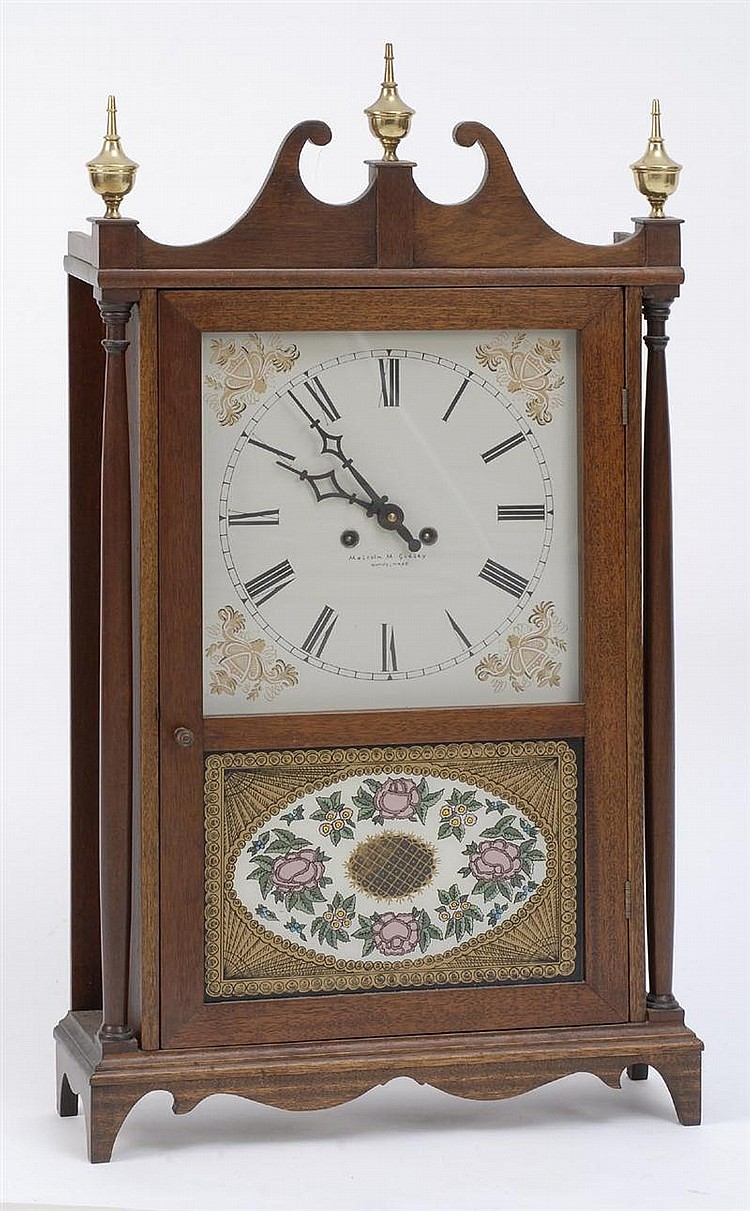 REPRODUCTION PILLAR & SCROLL CLOCK in mahogany. Painted dial signed