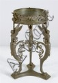 BRONZE WINE PEDESTAL with tripod base in a griffin design. Height 11