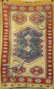 ORIENTAL RUG: TURKISH Blue medallion center on a yellow field with red border.
