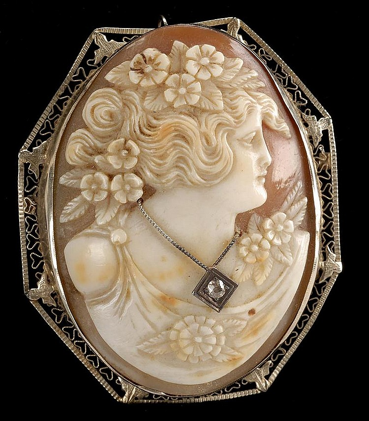 FINE 19TH CENTURY SHELL CAMEO AND DIAMOND BROOCH depicting a woman wearing flowers in her hair. Length 2½