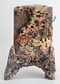 CHINESE CARVED SOAPSTONE SCREEN depicting three scholars reading a scroll. With soapstone stand. Height overall 10