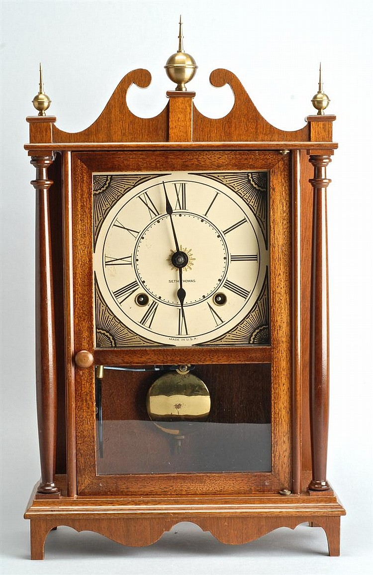 SETH THOMAS HALF-SIZE PILLAR & SCROLL CLOCK in mahogany case. Signed dial. Height 16¾