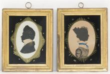 TWO CUT PAPER SILHOUETTES A man and a woman, both with gilt and watercolor highlights. 4.25