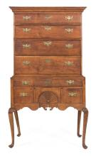 QUEEN ANNE FLAT-TOP HIGHBOY In maple and curly maple. Nicely molded pediment. Upper case with four full-width graduated drawers. Low...