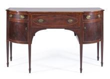 THOMAS SEYMOUR SIDEBOARD In mahogany and select mahogany veneer, with banded and string inlay. Three drawers over cupboard doors. Ta...