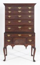 QUEEN ANNE FLAT-TOP HIGHBOY In maple with nice patina, possibly original. Upper case with well-proportioned stepped moldings over fi...