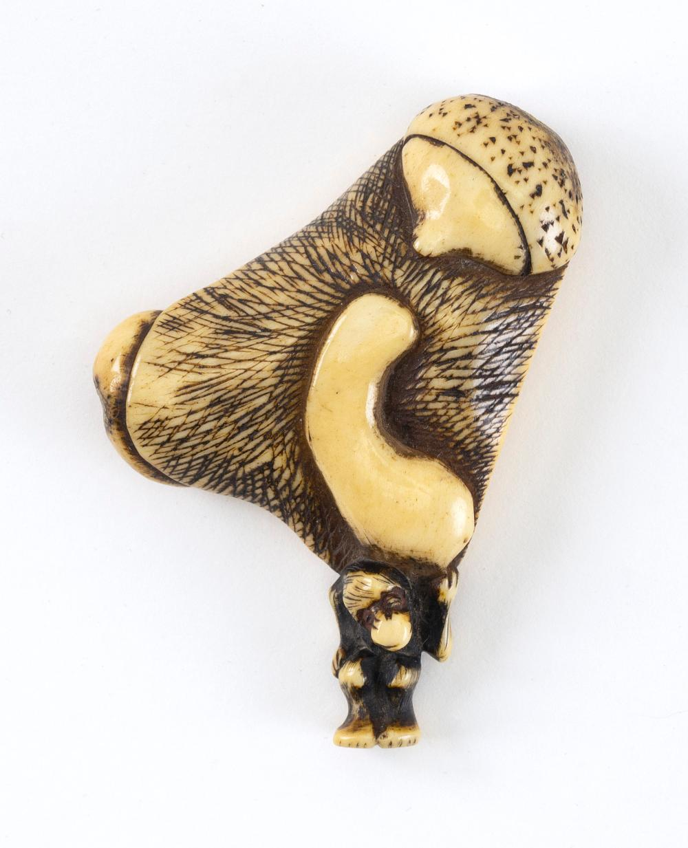 """JAPANESE STAG ANTLER NETSUKE Early 19th Century Height 2.25""""."""