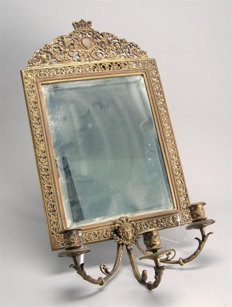 BRASS-FRAMED WALL MIRROR Three-socle candle sconce below beveled mirror glass. Height 24