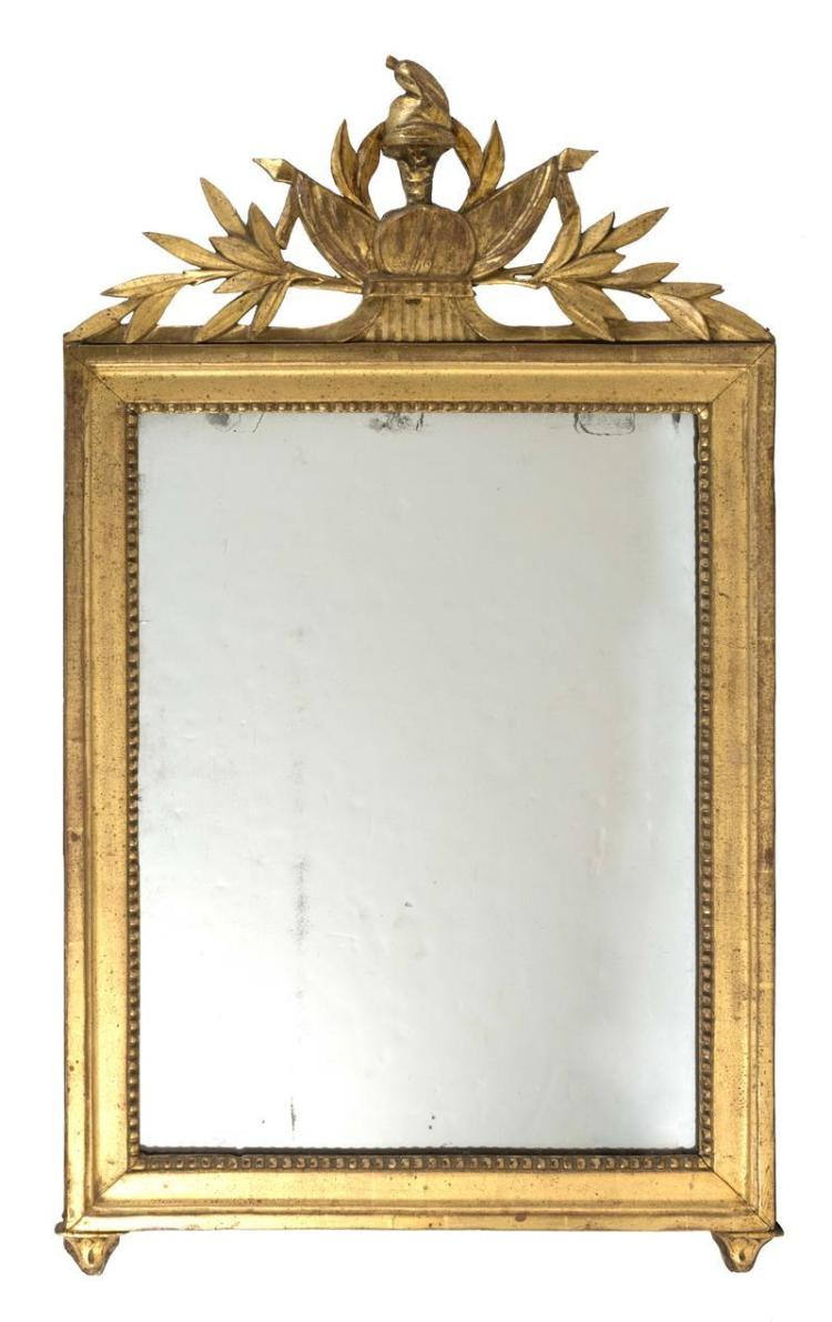 LOUIS-PHILIPPE GILTWOOD PIER MIRROR Pierced crest carved with a Phrygian Cap, or bonnet rouge, bunting and olive branches. Molded fr...