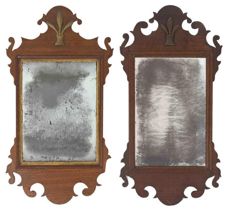 TWO SIMILAR ANTIQUE AMERICAN CHIPPENDALE MIRRORS In mahogany. Both crests with applied and gilded Prince of Wales plumes. 25.5