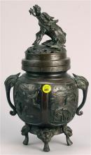 JAPANESE BRONZE COVERED CENSER In ovoid form. With quadruped base, elephant's-head handles, and relief bird decoration. Pierced cove..