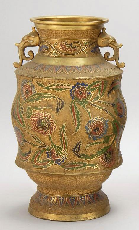 JAPANESE CHAMPLEVÉ ENAMEL VASE In baluster form. With relief foliate design and animal's-head handles. Height 14.25