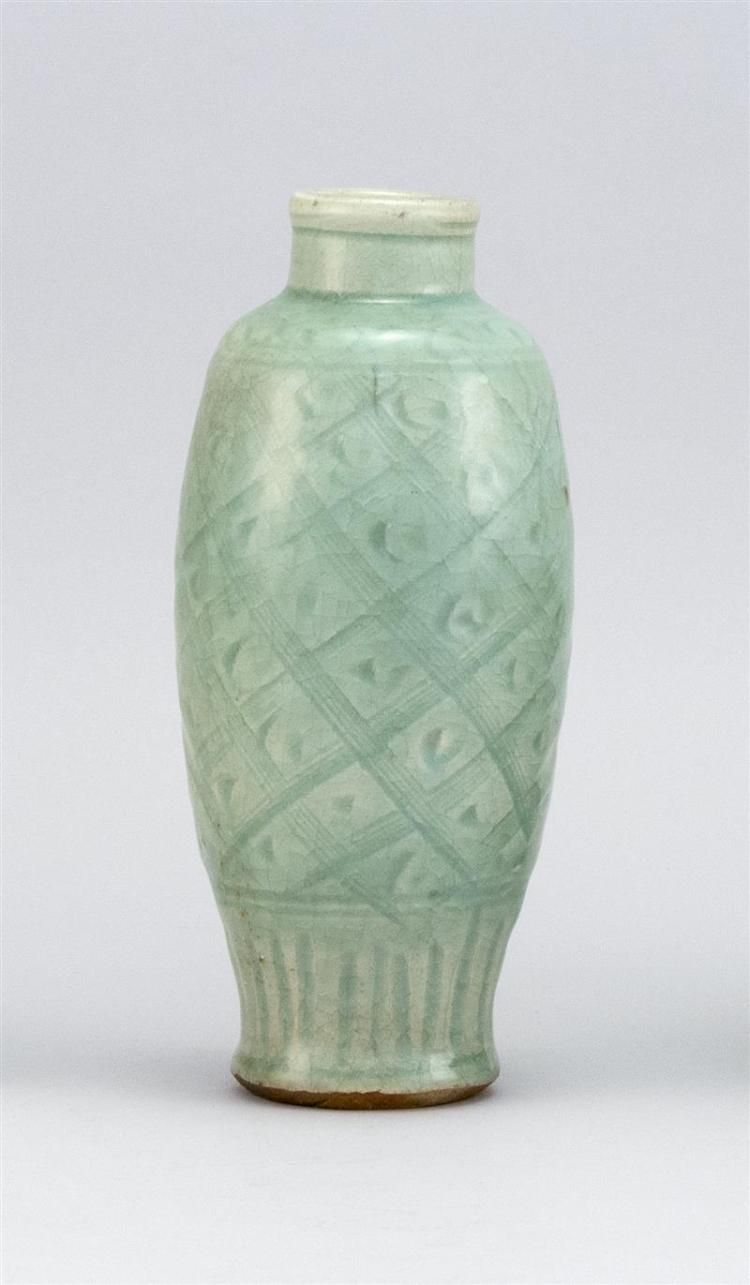 CHINESE CELADON STONEWARE BOTTLE/VASE In seed form with trellis design. Height 8.5