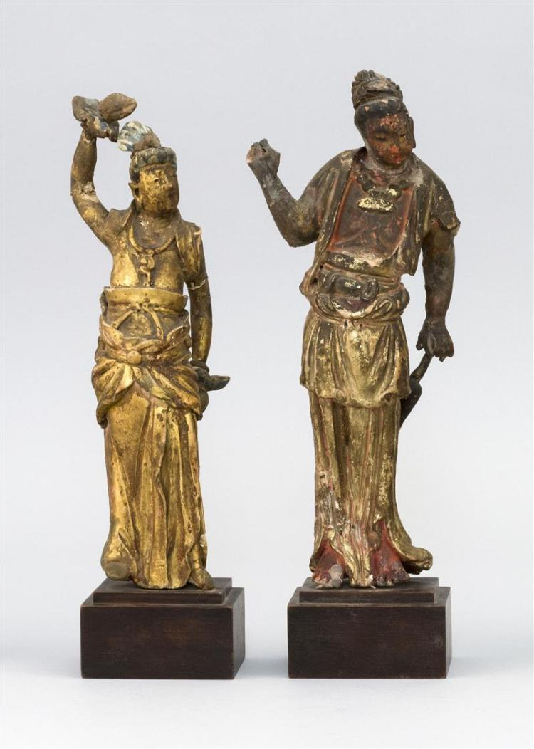 PAIR OF CHINESE GILT AND POLYCHROME GESSO FIGURES Both in standing position. One holding a peach and the other holding a bottle vase...