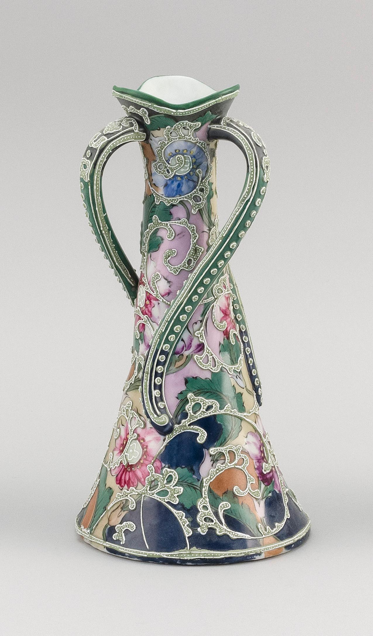 """MORIAGE NIPPON PORCELAIN VASE Conical, with three twisting handles and an elaborate floral design. Height 10.5""""."""
