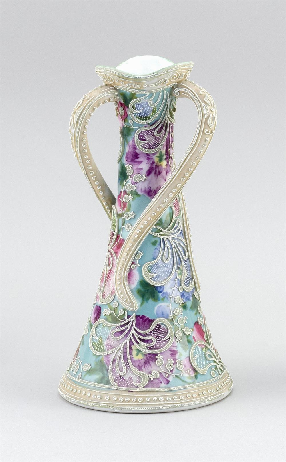 "MORIAGE NIPPON PORCELAIN VASE Conical, with three twisting handles. Moriage bellflower design on a floral-patterned ground. Height 10""."