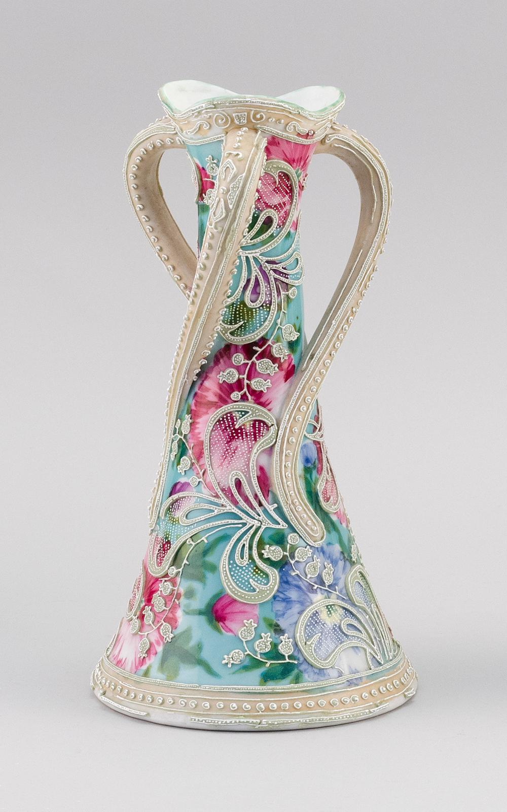 MORIAGE NIPPON PORCELAIN VASE Conical, with three twisting handles. Moriage bellflower design on a floral-patterned ground. Height 10