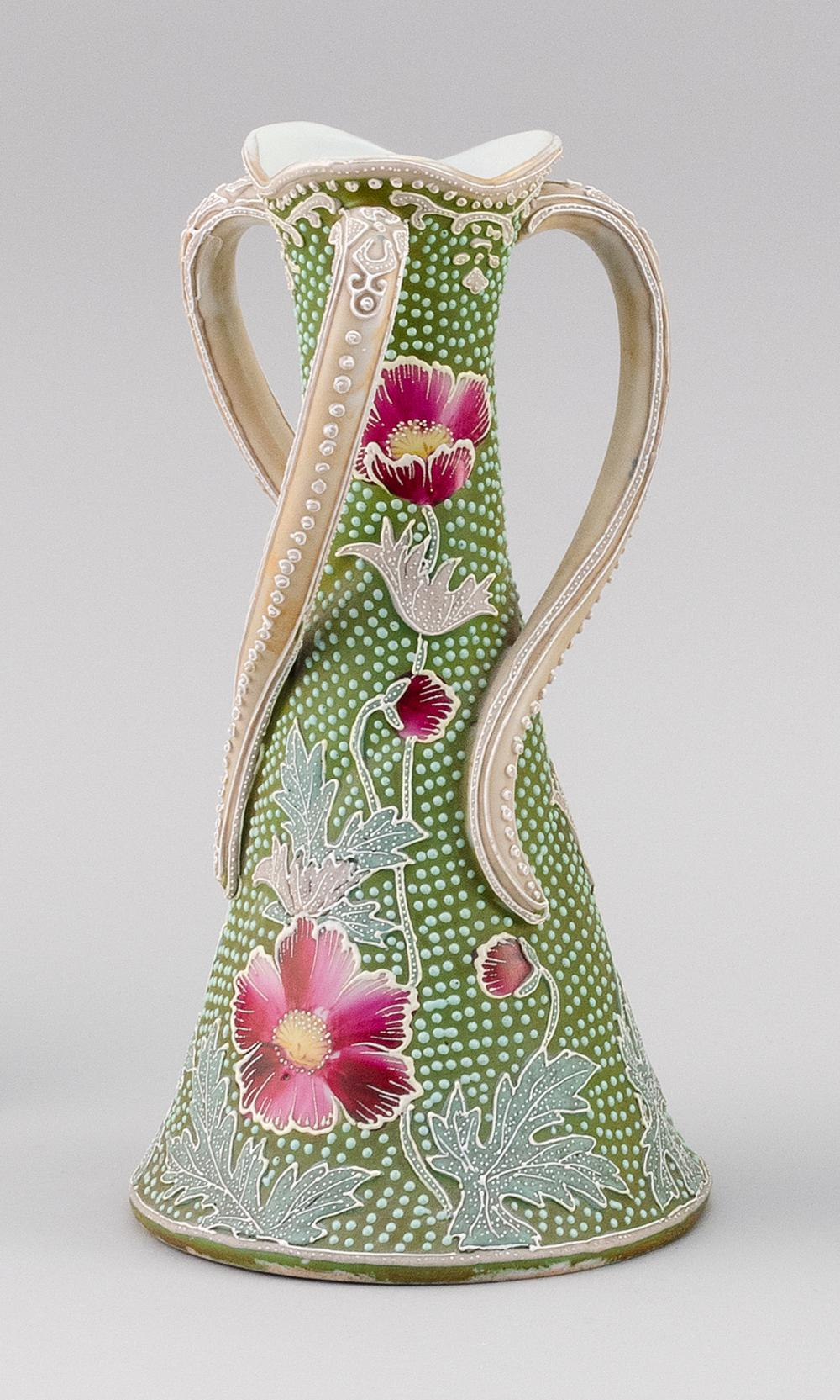 MORIAGE NIPPON PORCELAIN VASE Conical, with three twisting handles and a floral design. Spotted with jewel-like markings. Height 10