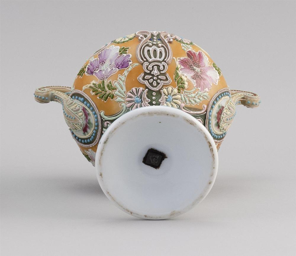 MORIAGE NIPPON PORCELAIN FOOTED COMPOTE Ovoid, with openwork handle and a floral design. Height 8.5
