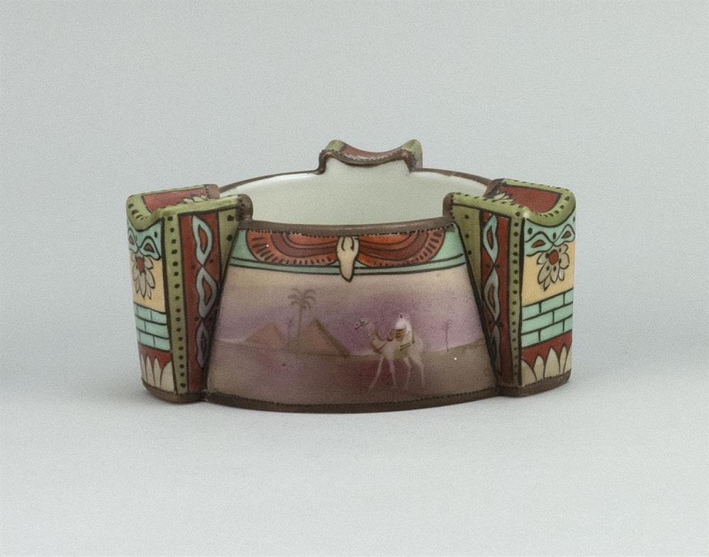 NIPPON PORCELAIN ASHTRAY Circular, with three relief handles and decoration of Egyptian motifs. Van Patten #47 mark on base. Diamete...