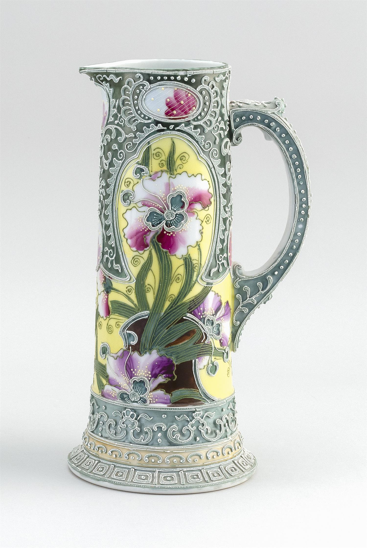 """MORIAGE NIPPON PORCELAIN PITCHER In modified cylinder form, with dramatic floral decoration. Height 11.8""""."""
