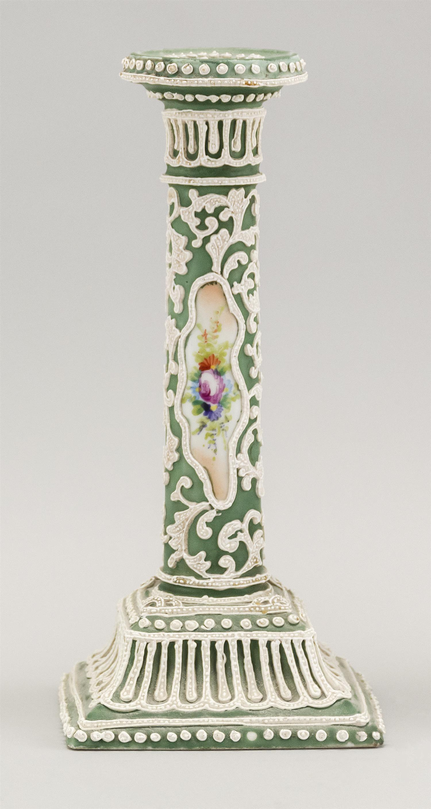 """MORIAGE NIPPON PORCELAIN CANDLESTICK With floral cartouches on a green and white ground. Height 9.5""""."""