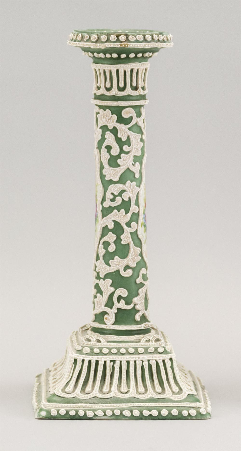 MORIAGE NIPPON PORCELAIN CANDLESTICK With floral cartouches on a green and white ground. Height 9.5