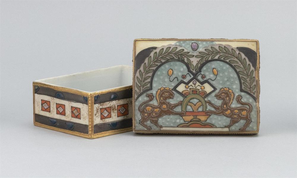 "NIPPON PORCELAIN BOX Rectangular, with relief enamel decoration of a lion crest. Van Patten #47 mark on base. Length 4.4""."