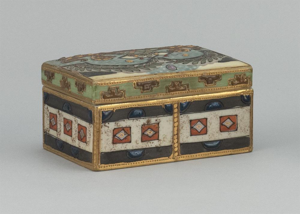 NIPPON PORCELAIN BOX Rectangular, with relief enamel decoration of a lion crest. Van Patten #47 mark on base. Length 4.4