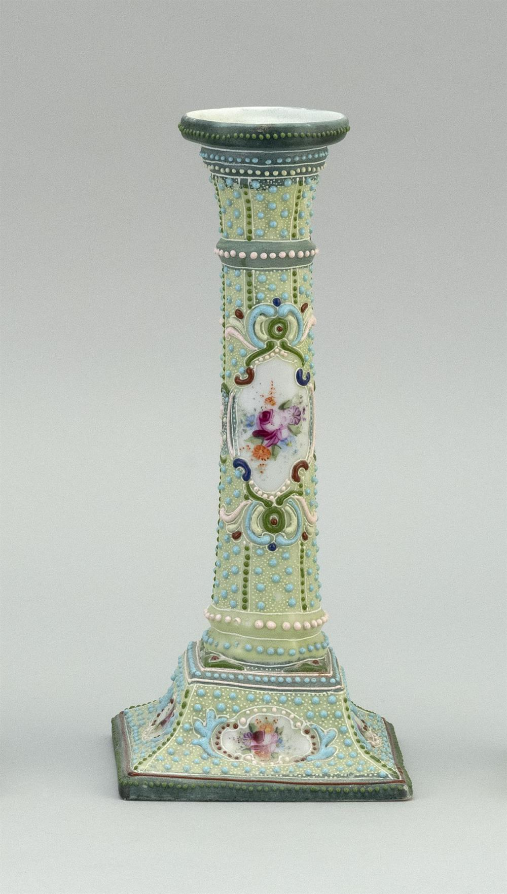"MORIAGE NIPPON PORCELAIN CANDLESTICK With floral cartouches on a beaded ground. Height 9.4""."
