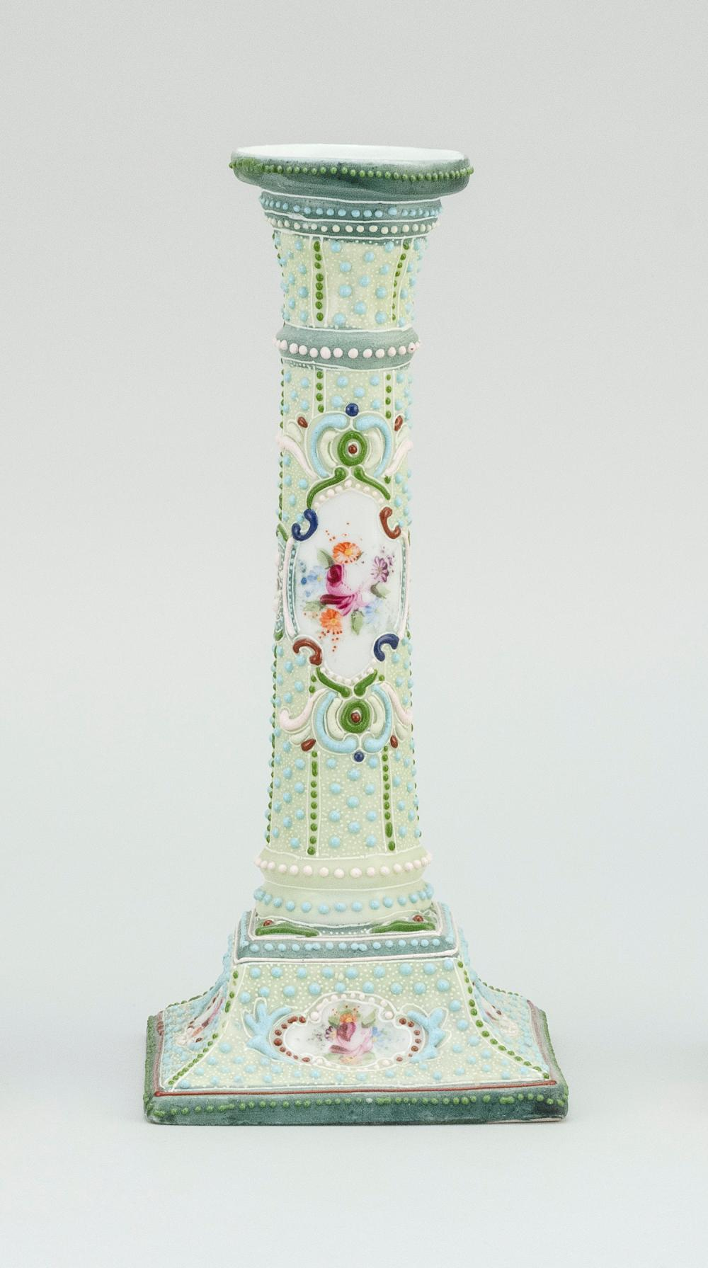 MORIAGE NIPPON PORCELAIN CANDLESTICK With floral cartouches on a beaded ground. Height 9.4