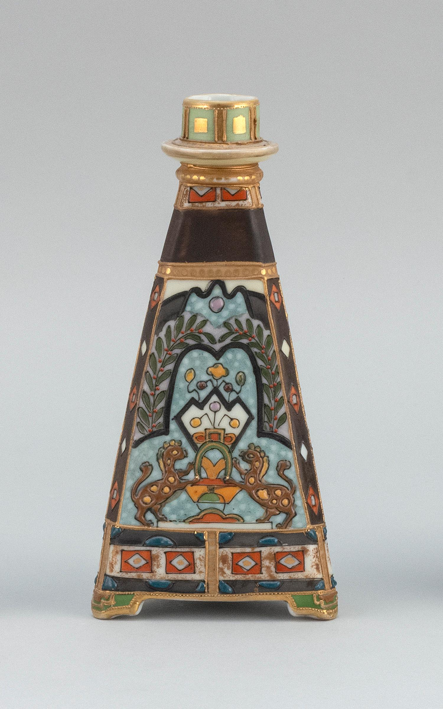 "NIPPON PORCELAIN CANDLESTICK In pyramid form, with relief design of a lion crest. Van Patten #47 mark on base. Height 8""."