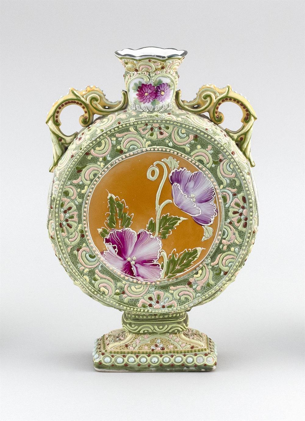 MORIAGE NIPPON PORCELAIN BOTTLE VASE In pilgrim flask form, with openwork handles, rectangular base and floral decoration. Height 10...