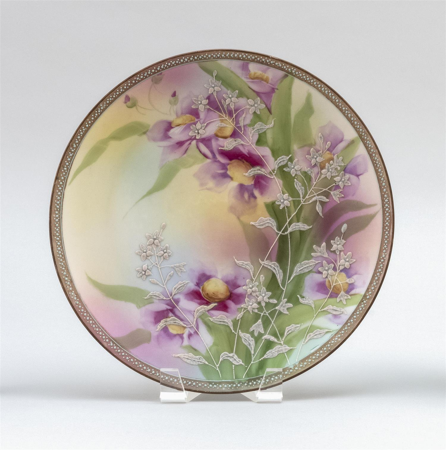 "MORIAGE NIPPON PORCELAIN PLAQUE With a floral design on a purple floral-patterned ground. Van Patten #52 mark on base. Diameter 10""."
