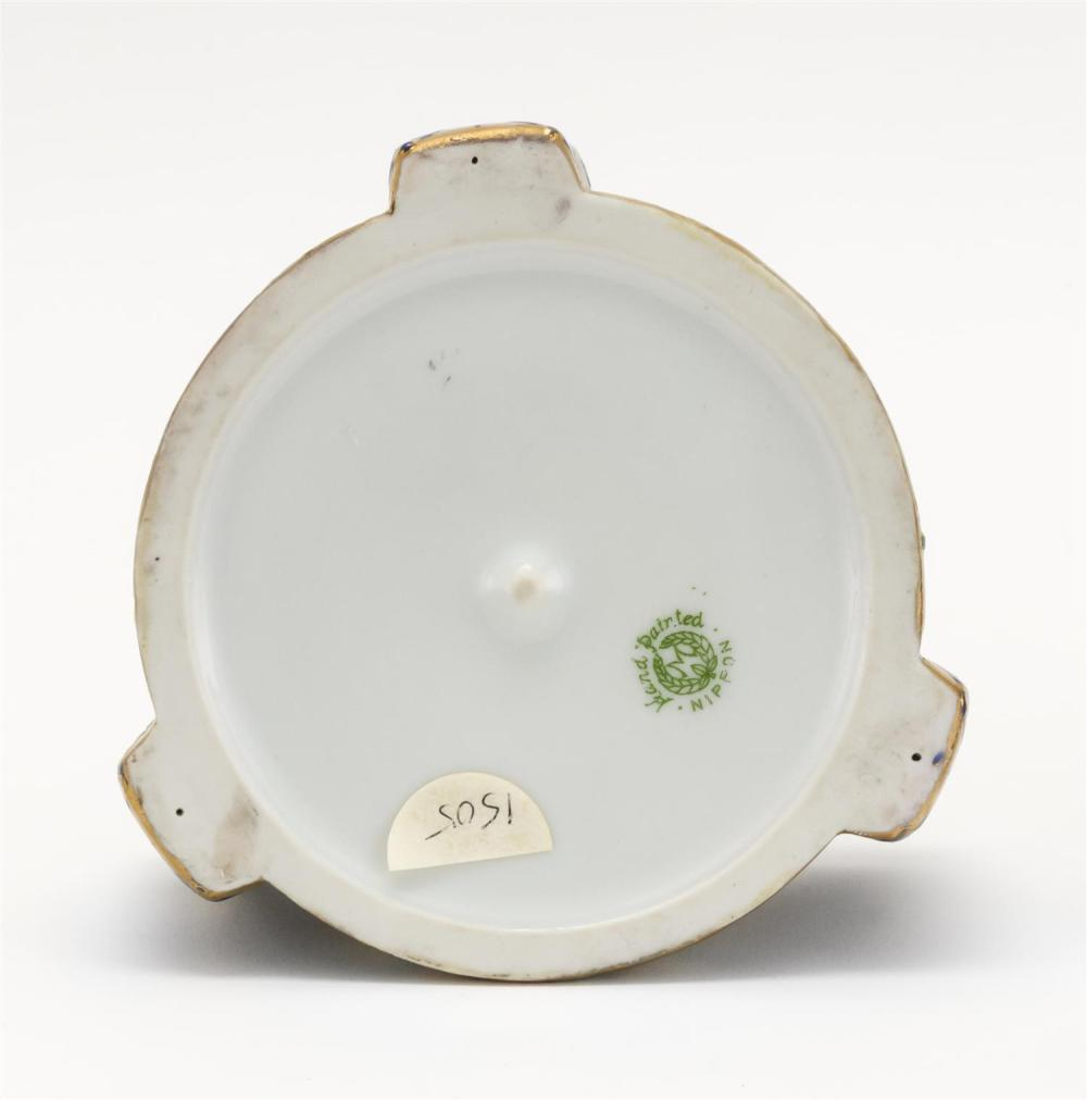 NIPPON PORCELAIN ASHTRAY Circular, with three handles and decoration of Egyptian motifs. Diameter 4.5