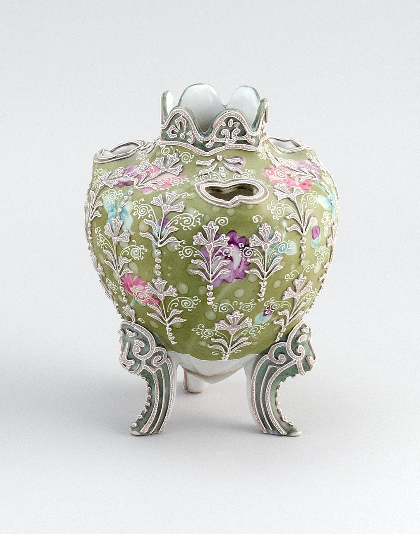 """MORIAGE NIPPON PORCELAIN NARCISSUS VASE Ovoid, with tripod base and floral decoration. Height 6.5""""."""