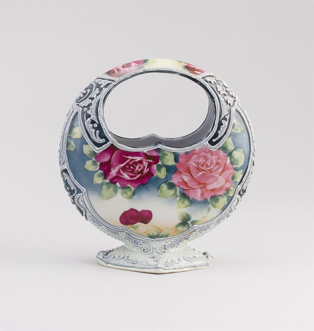 MORIAGE NIPPON PORCELAIN VASE In basket form, with a rose design highlighted with moriage. Circular cherry blossom mark on base. Hei...