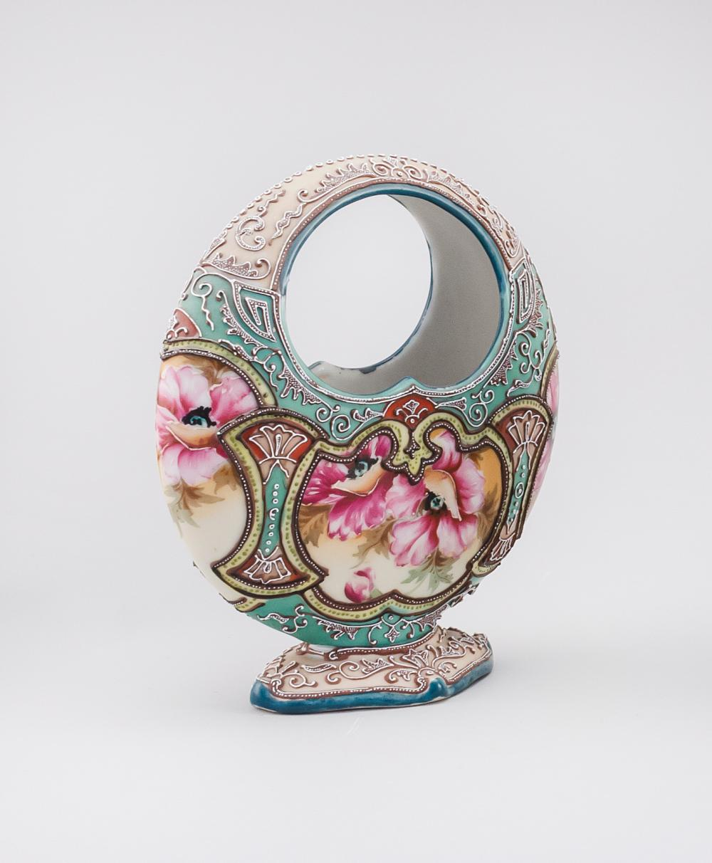 MORIAGE NIPPON PORCELAIN VASE In basket form, with floral design. Height 7.75