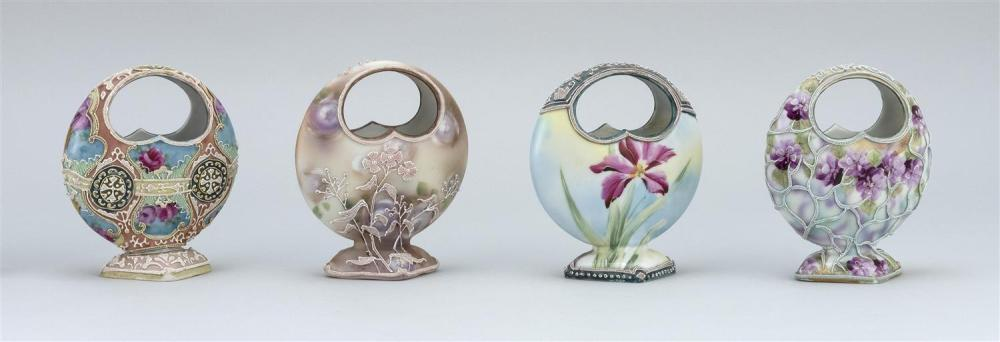 "FOUR MORIAGE NIPPON PORCELAIN VASES All in basket form, with floral designs. Two with moriage mark on base. Heights 5""."