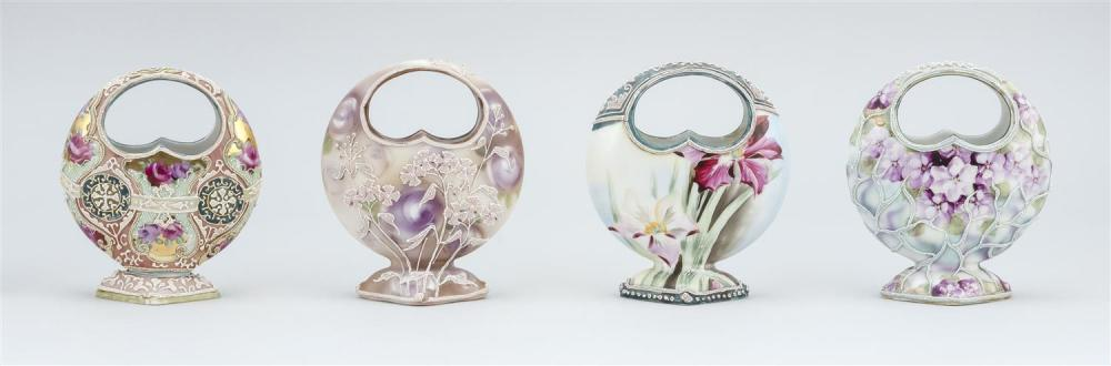 FOUR MORIAGE NIPPON PORCELAIN VASES All in basket form, with floral designs. Two with moriage mark on base. Heights 5
