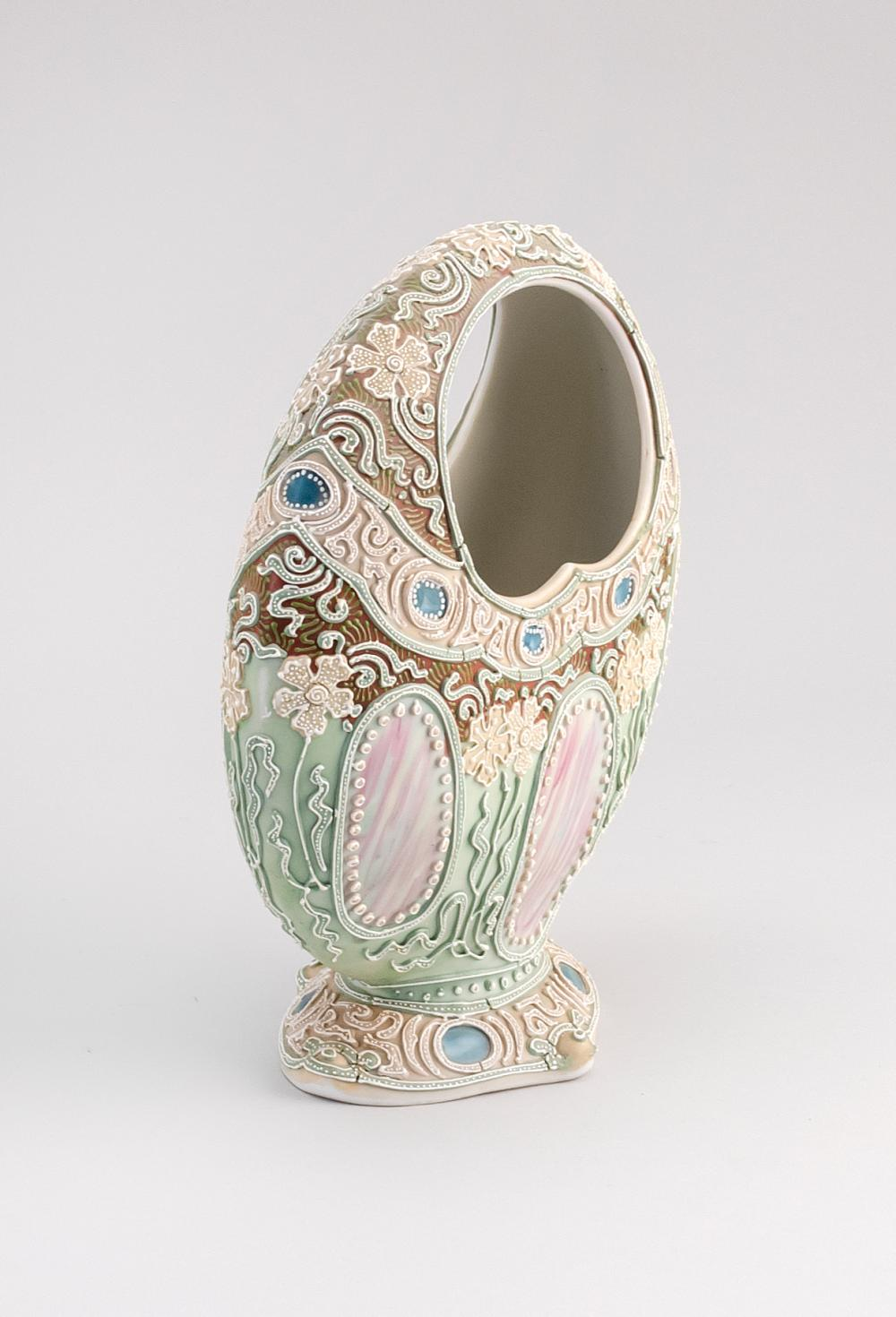 MORIAGE NIPPON PORCELAIN VASE In basket form, with stylized floral design. Height 8.75