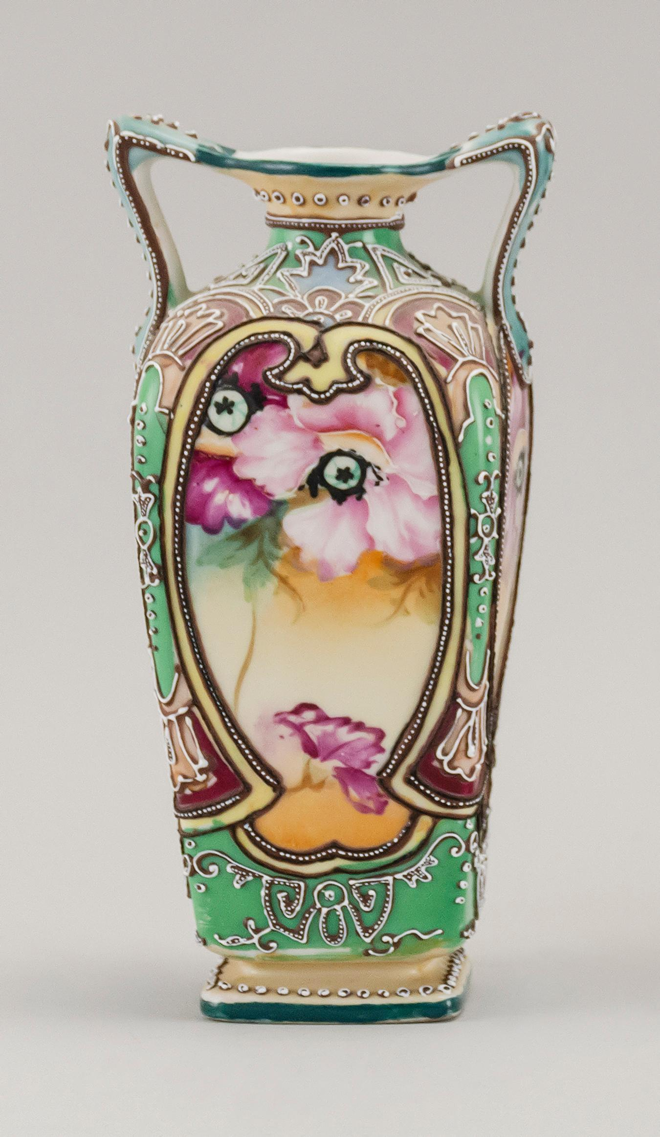 """MORIAGE NIPPON PORCELAIN VASE In modified rectangular form, with two handles and floral decoration. Trident mark on base. Height 7""""."""