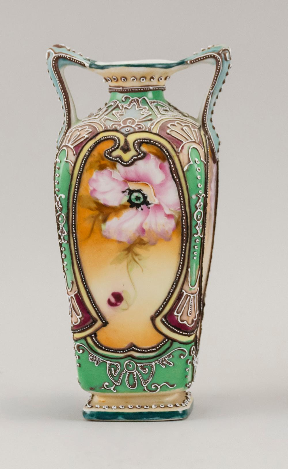 MORIAGE NIPPON PORCELAIN VASE In modified rectangular form, with two handles and floral decoration. Trident mark on base. Height 7